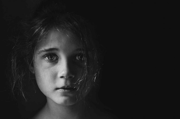Emotive black & white portrait of child's face by Helen Whittle