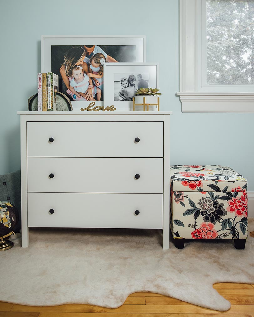 Millers print lab framed photo decor on a dresser in a bedroom at home