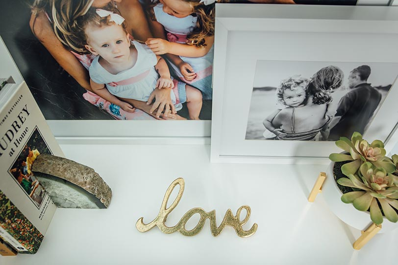 Miller's professional imaging photo decor frames on a dresser at home