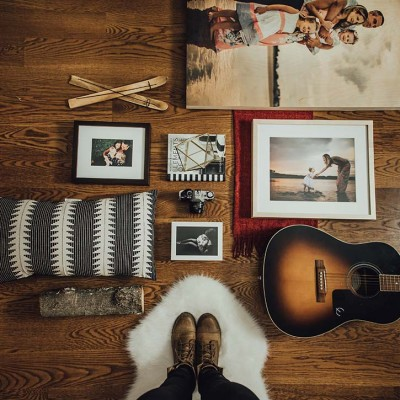 photo decor laid out on a wood floor