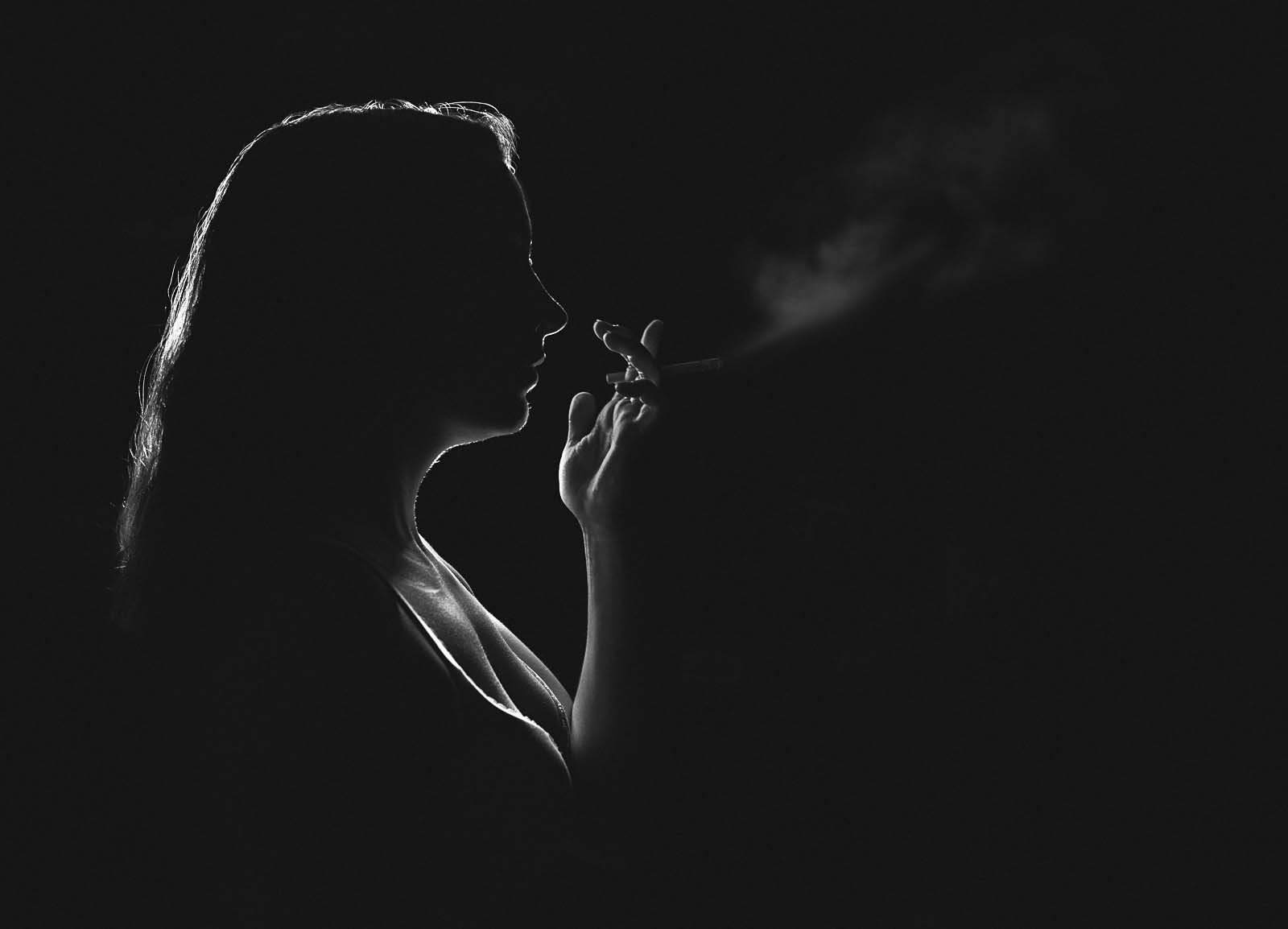 Self portrait using rim light by Megan Arndt to demonstrate creative photography method