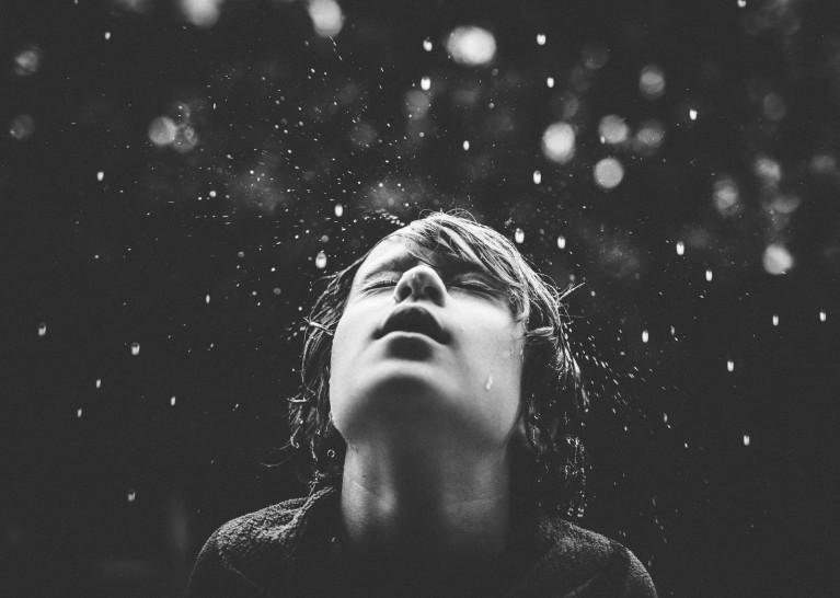 A boy's face in the rain