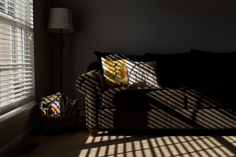 Dramatic light in a favorite photo spot at home on a sofa by Jonica Weiler
