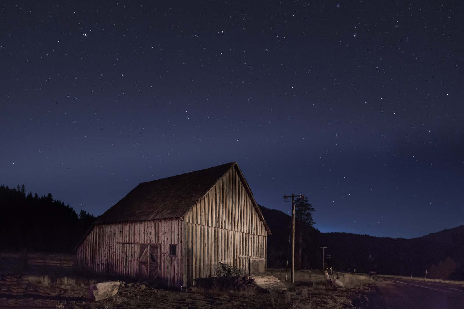 Light painting on a barn, photography at night, shooting after sunset