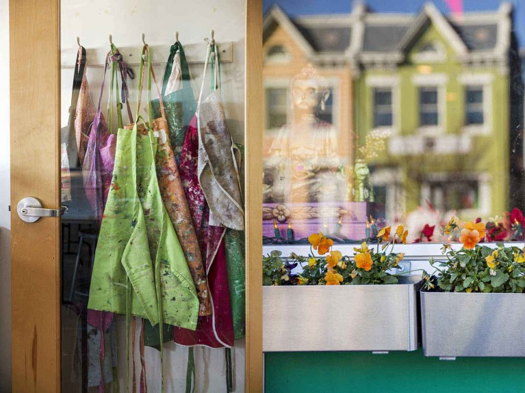 A diptych of art smocks and a colorful house