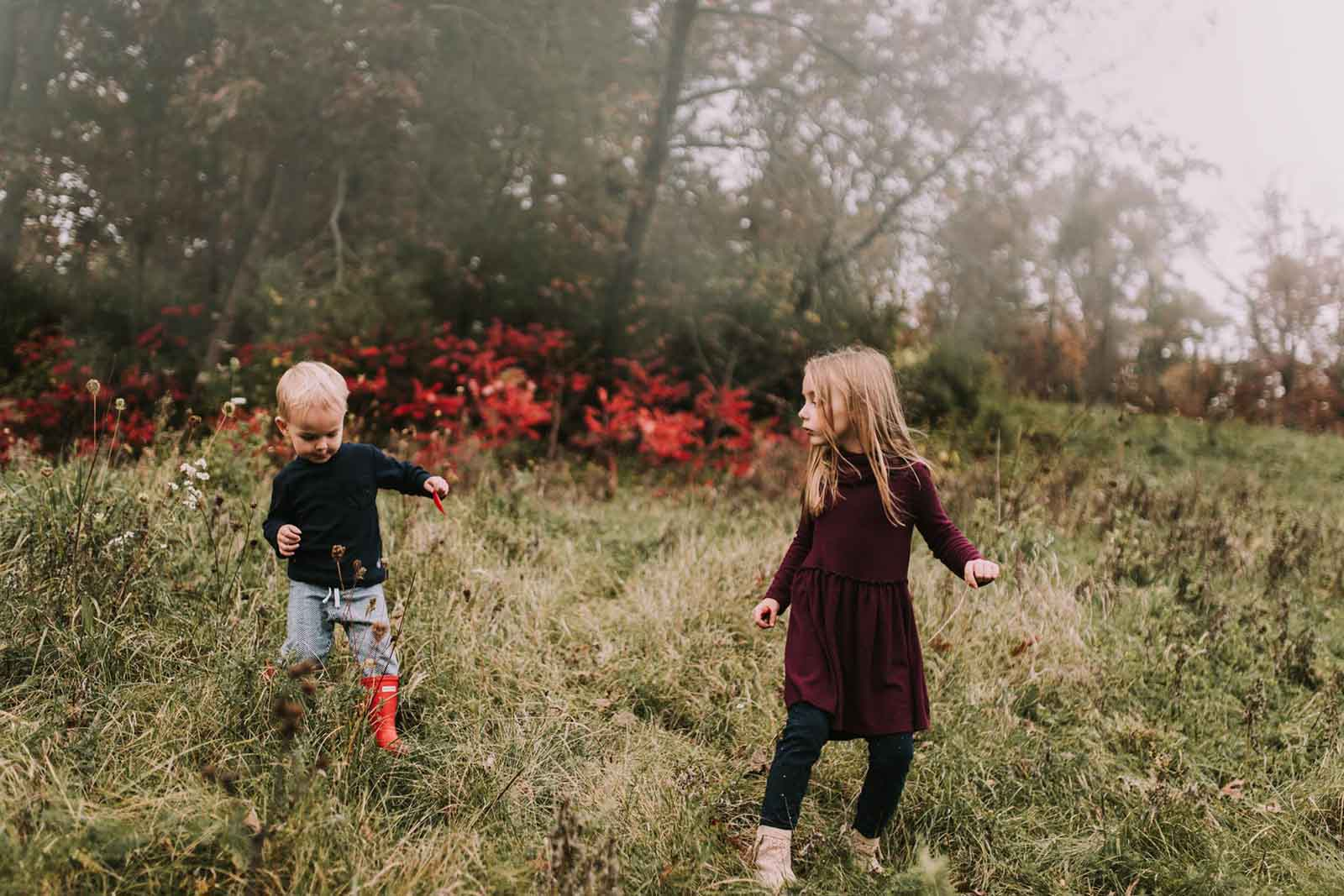 A girl and a boy play. Finding balance with photography and motherhood