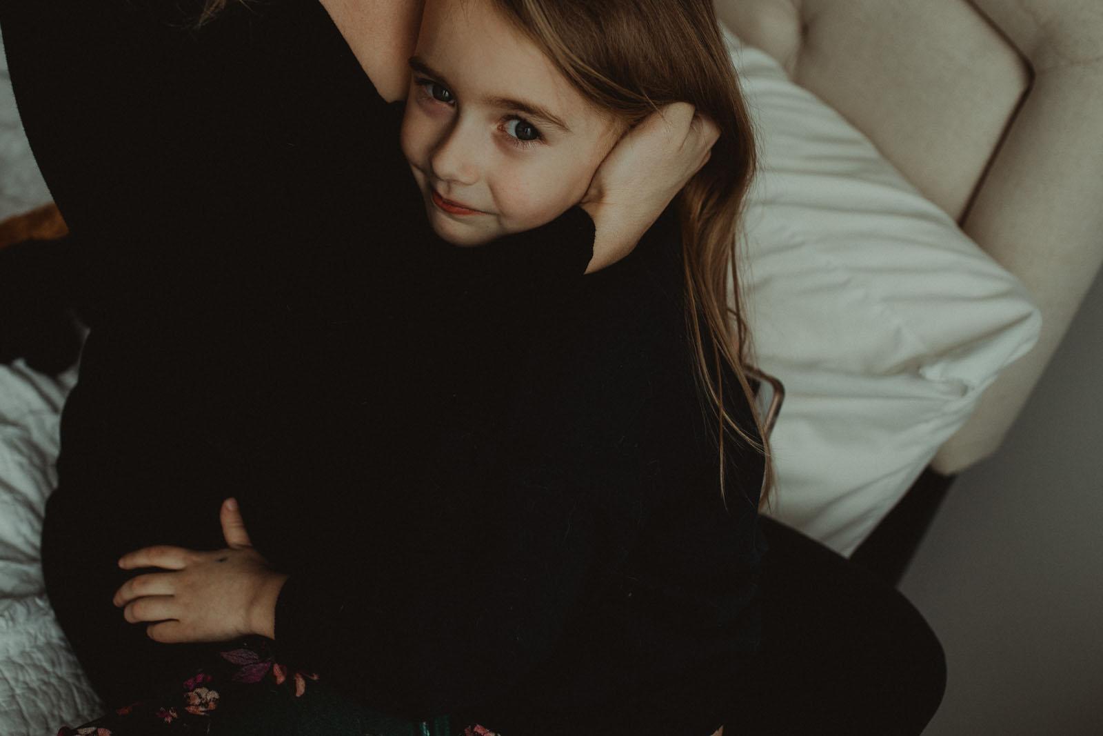 Mom hugging child. Finding balance with photography and motherhood