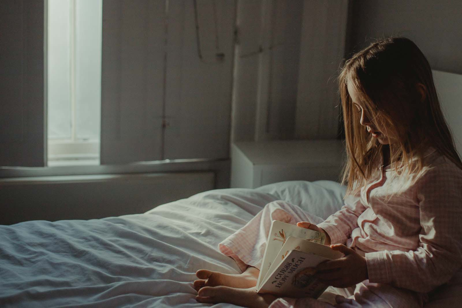 Girl reading. Finding balance with photography and motherhood