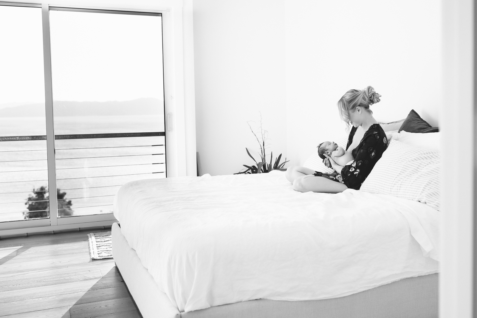 Woman on a bed with a newborn baby - Minimalism can make you a more creative photographer