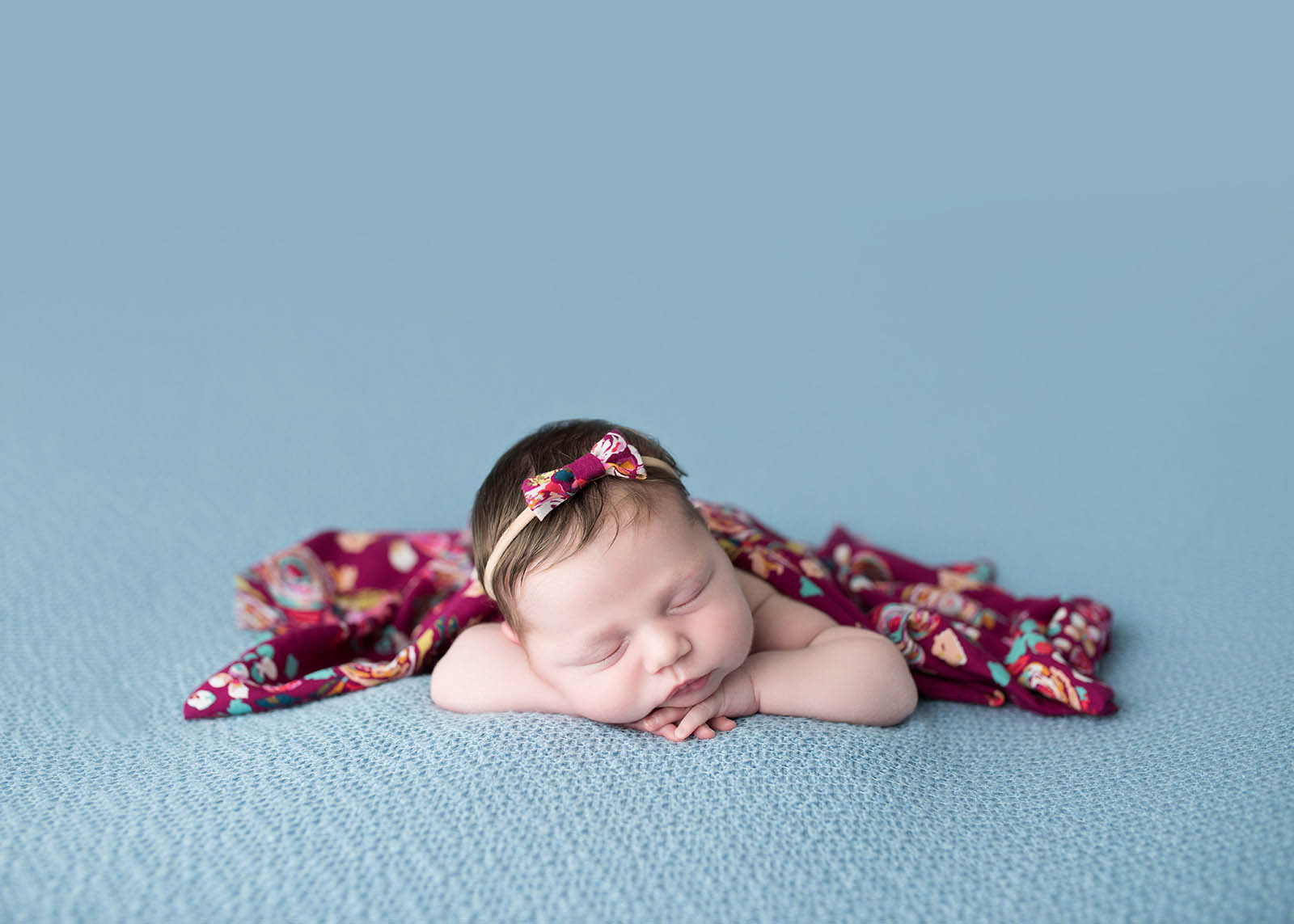 Newborn baby on blue blanket