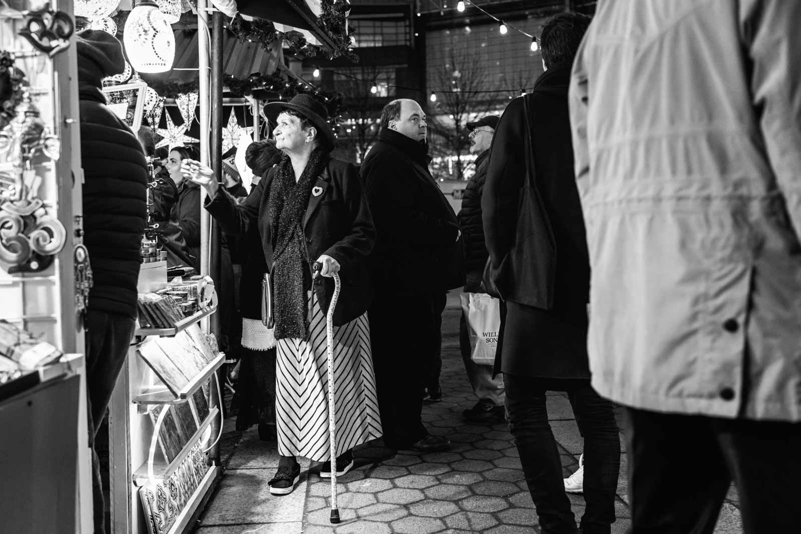 Street photography of a flea market in black and white