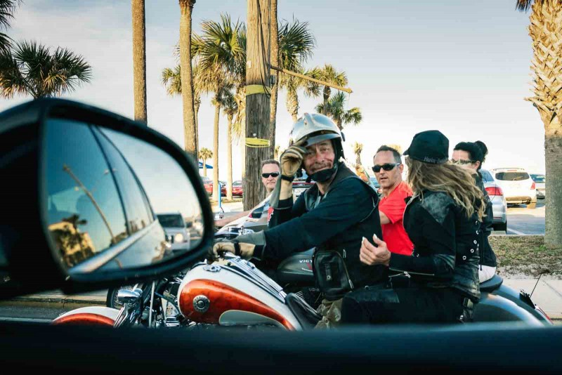 People in a motorcycle in a street photo