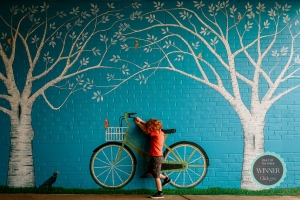 Small Icon-Amanda-Barrick-redhead-boy-with-wall-art-bicycle