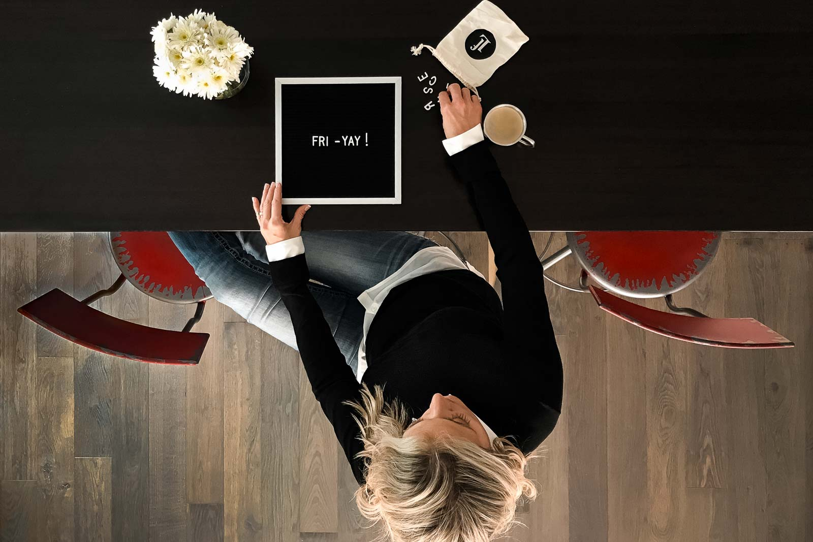 selfie from above of a woman creating message on a letter board