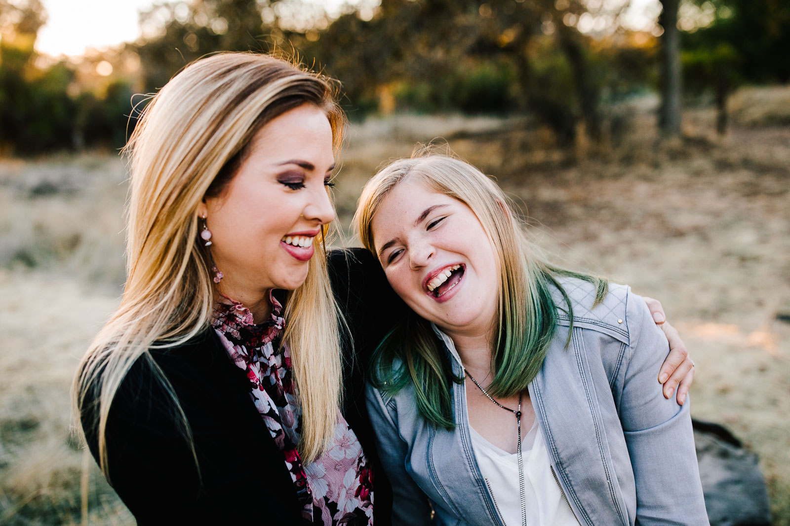 A mom and daughter laughing - How to get natural smiles in photos