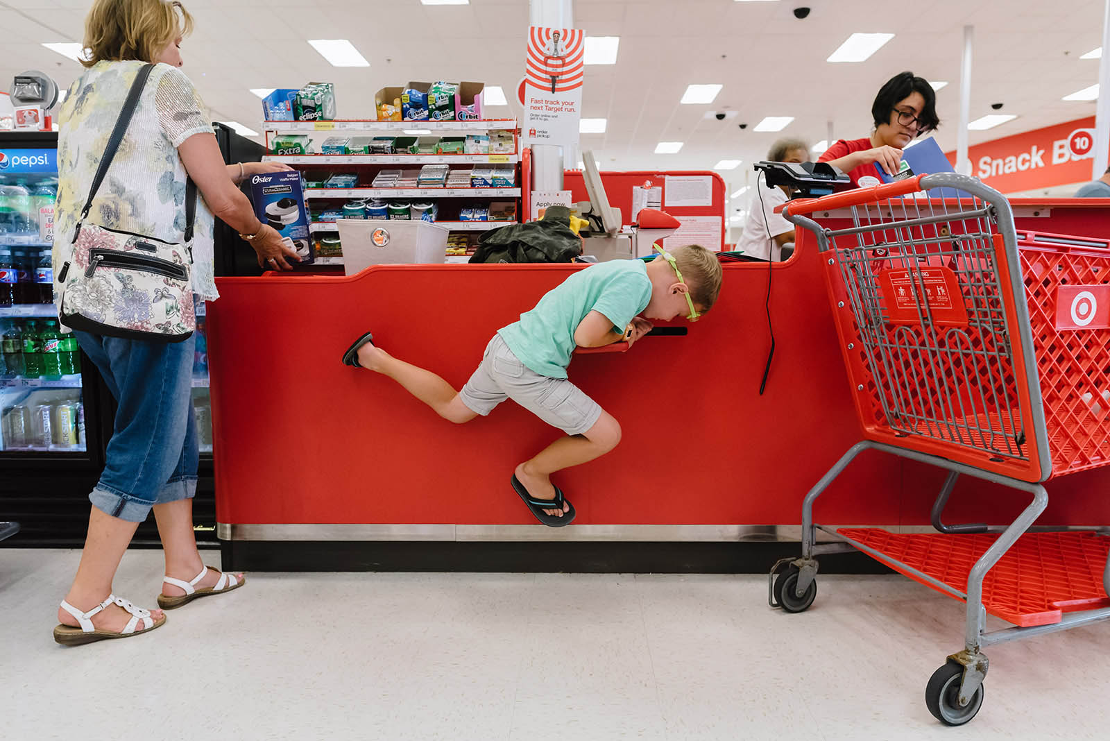 A boy plays in the checkout line at Target - humor in everyday images