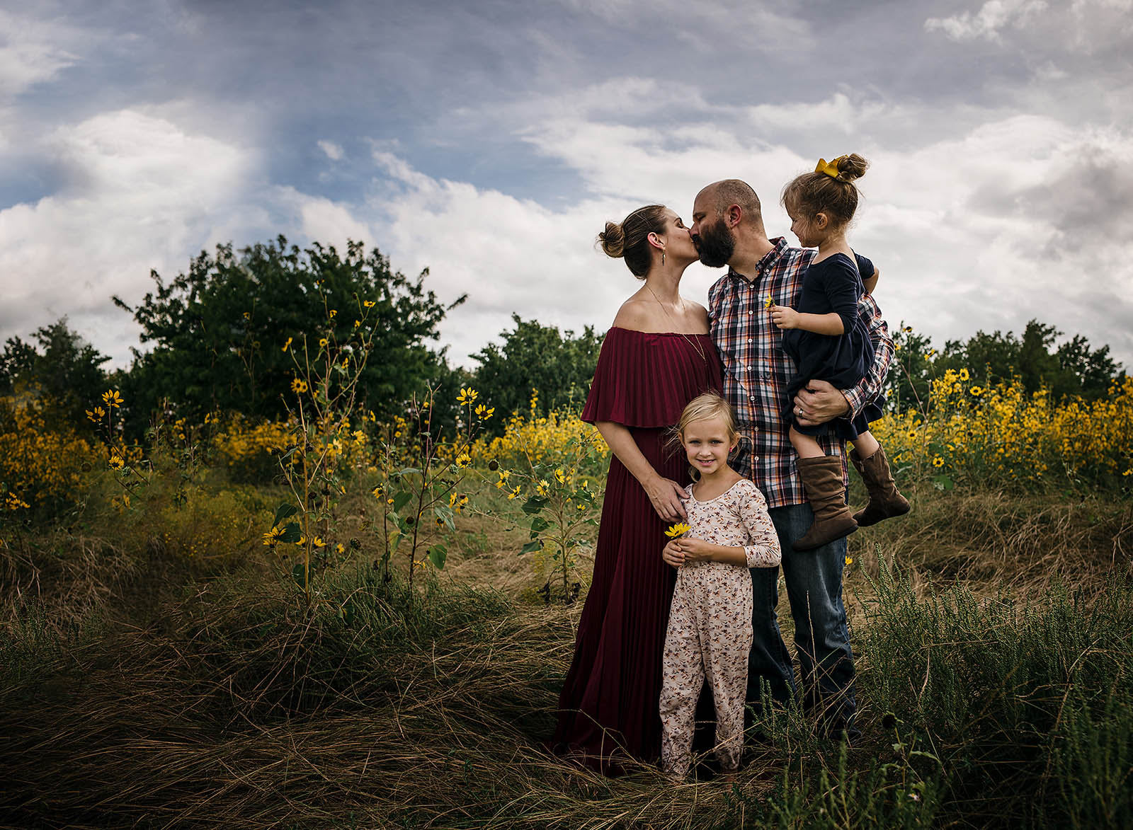 A family stands in a field of flowers in this printed photo