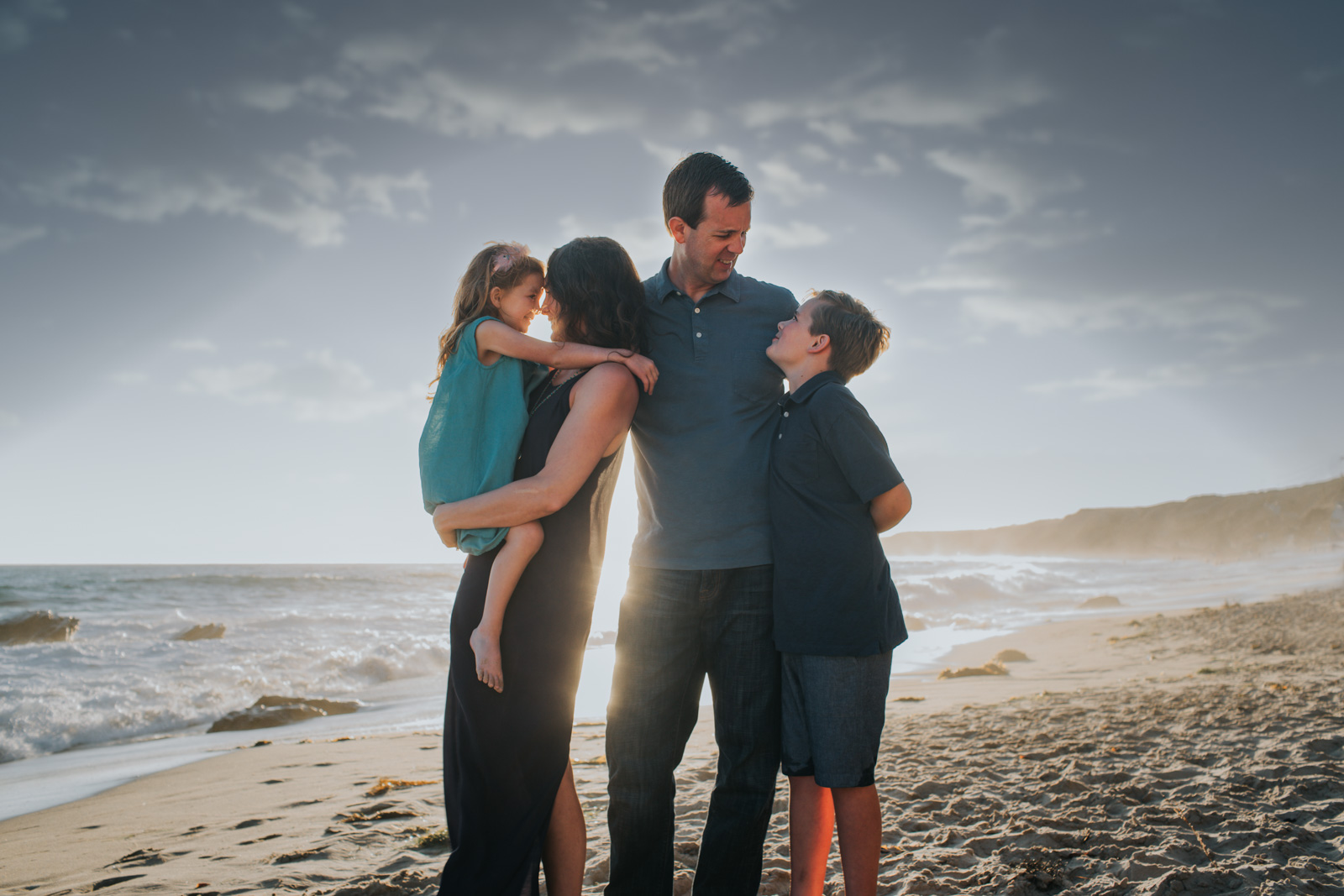 A family of four at sunset - How to photograph children with special needs