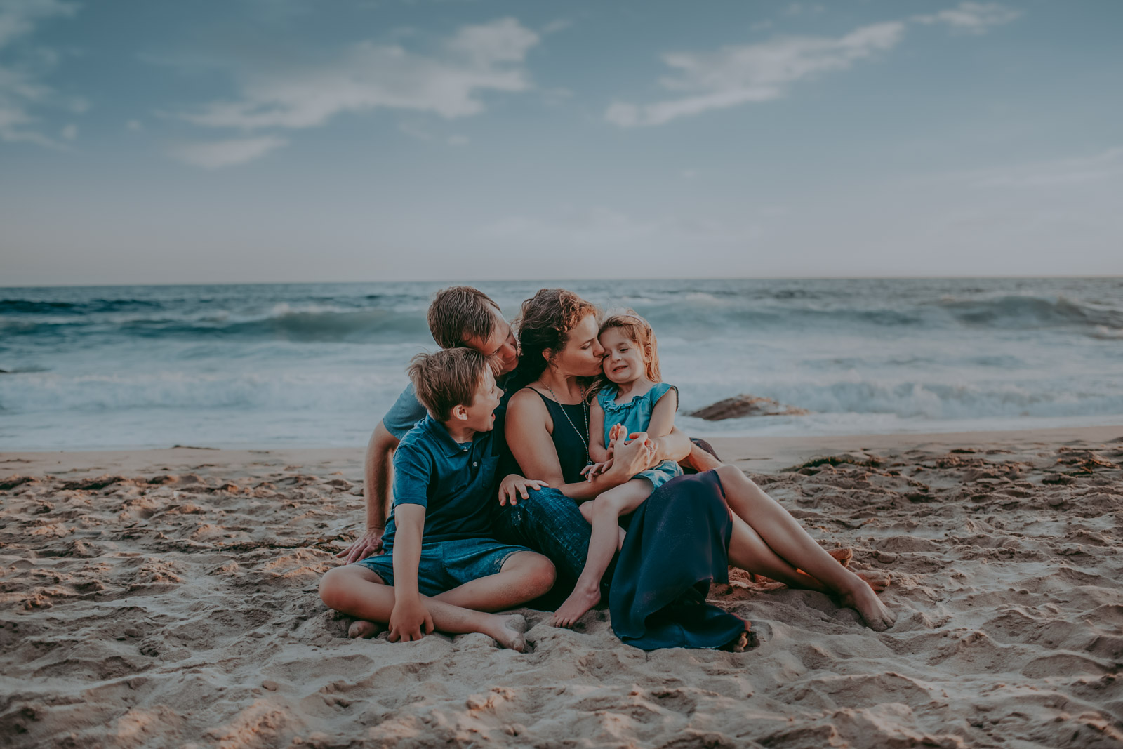 A family poses on the beach — How to photograph families of special needs children