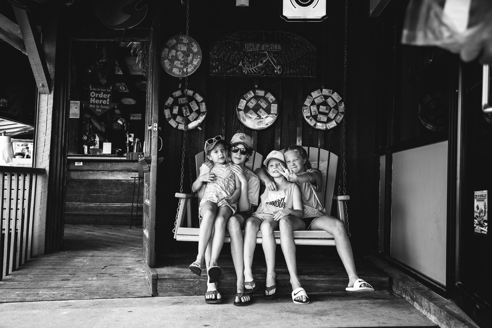 Kids on a bench in a still black and white photo during a video fusion photo session