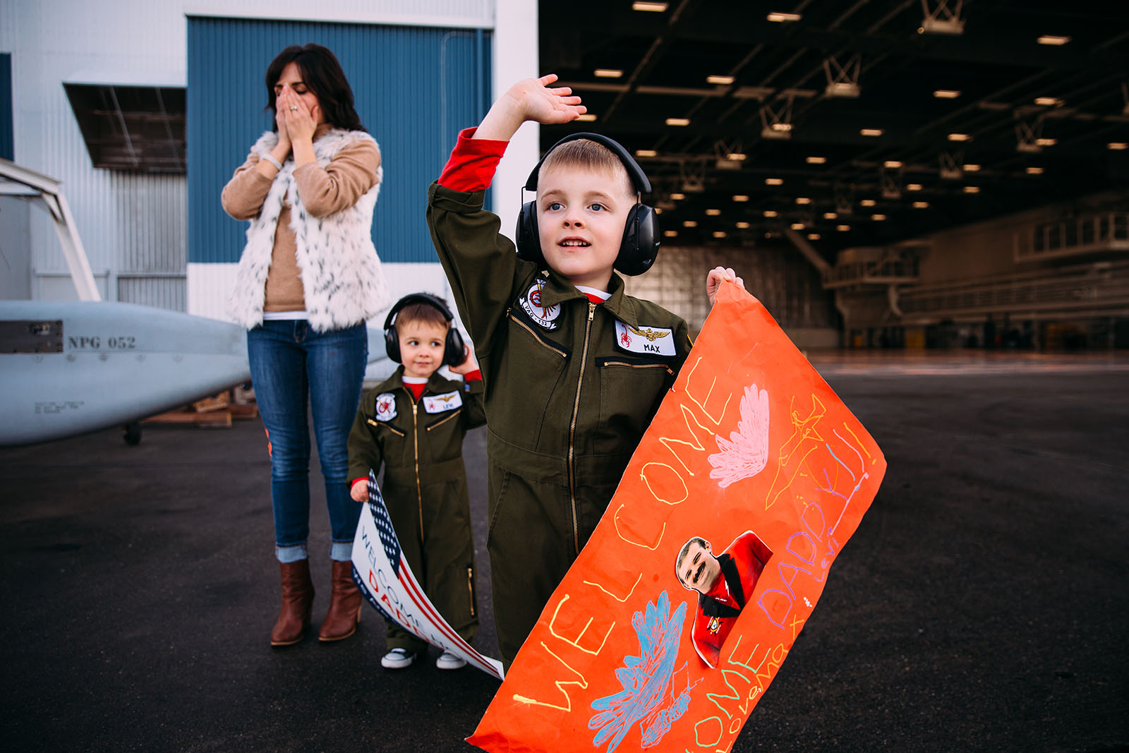 A little boy waits for his father at a military homecoming