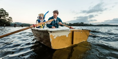 Dad and son in a rowboat