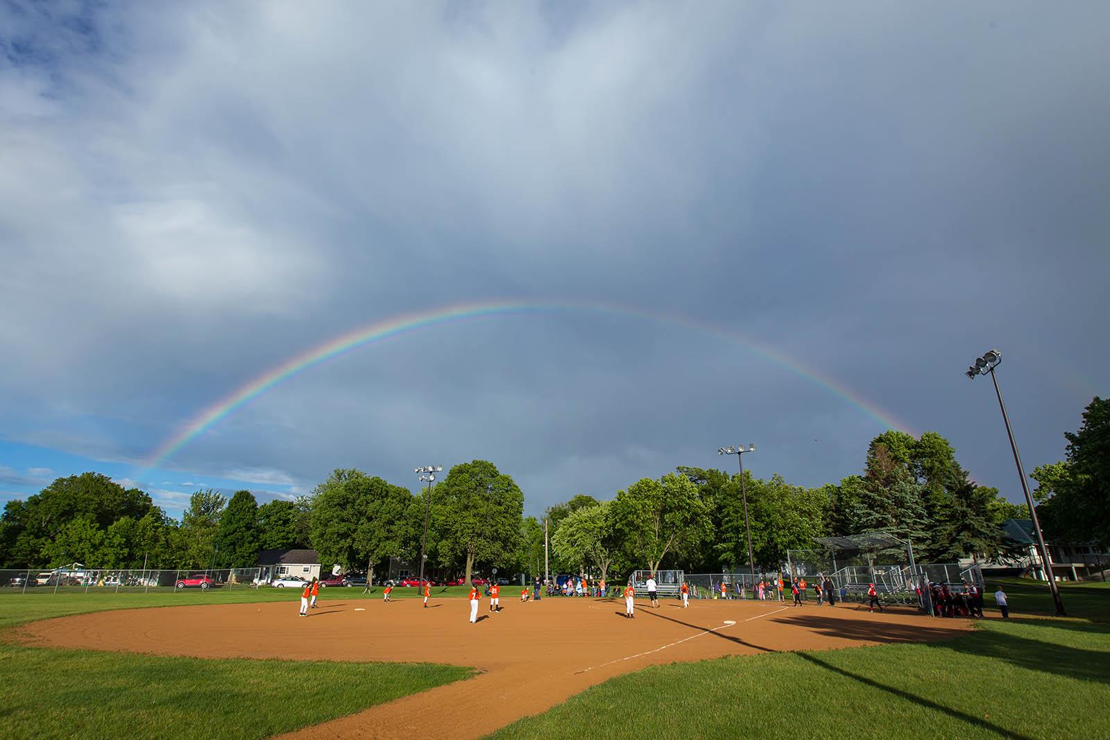 rainbow over a baseball field