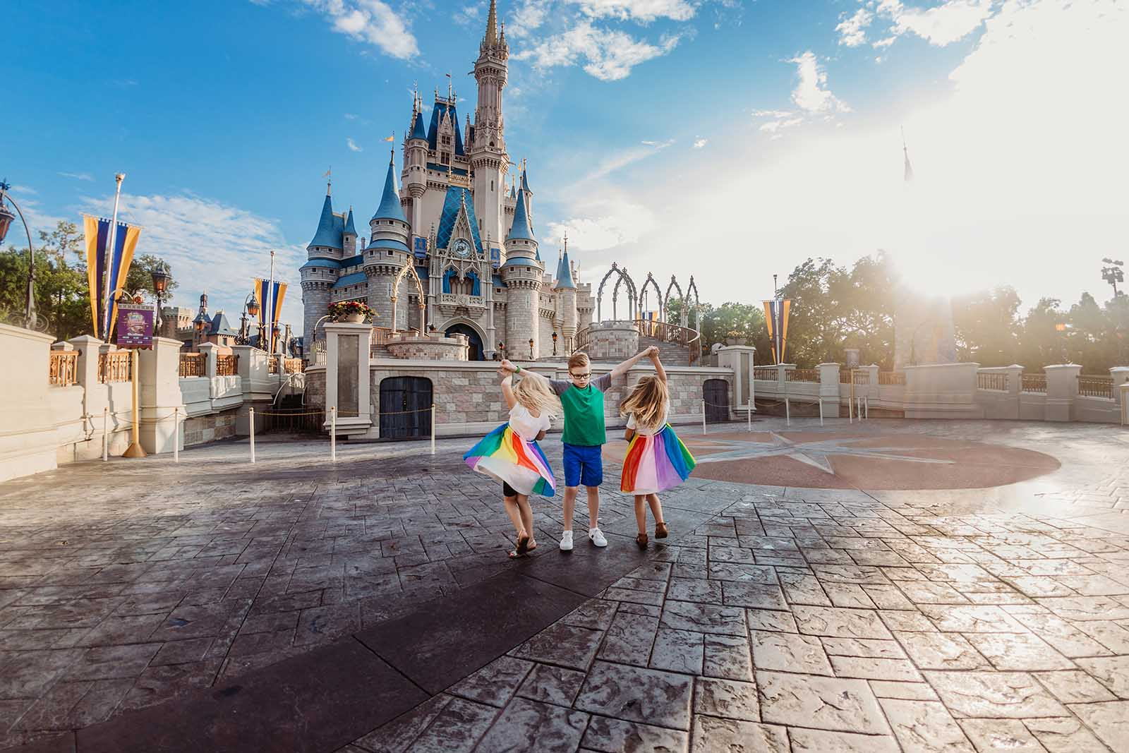 Colorful photo of kids at Disney - How to use color in photography - Rainbow prop
