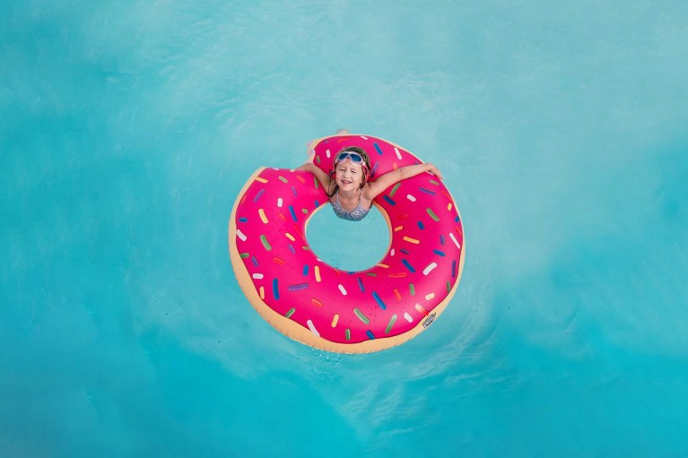 Pool floats as photo props - adding a pop of color in photos