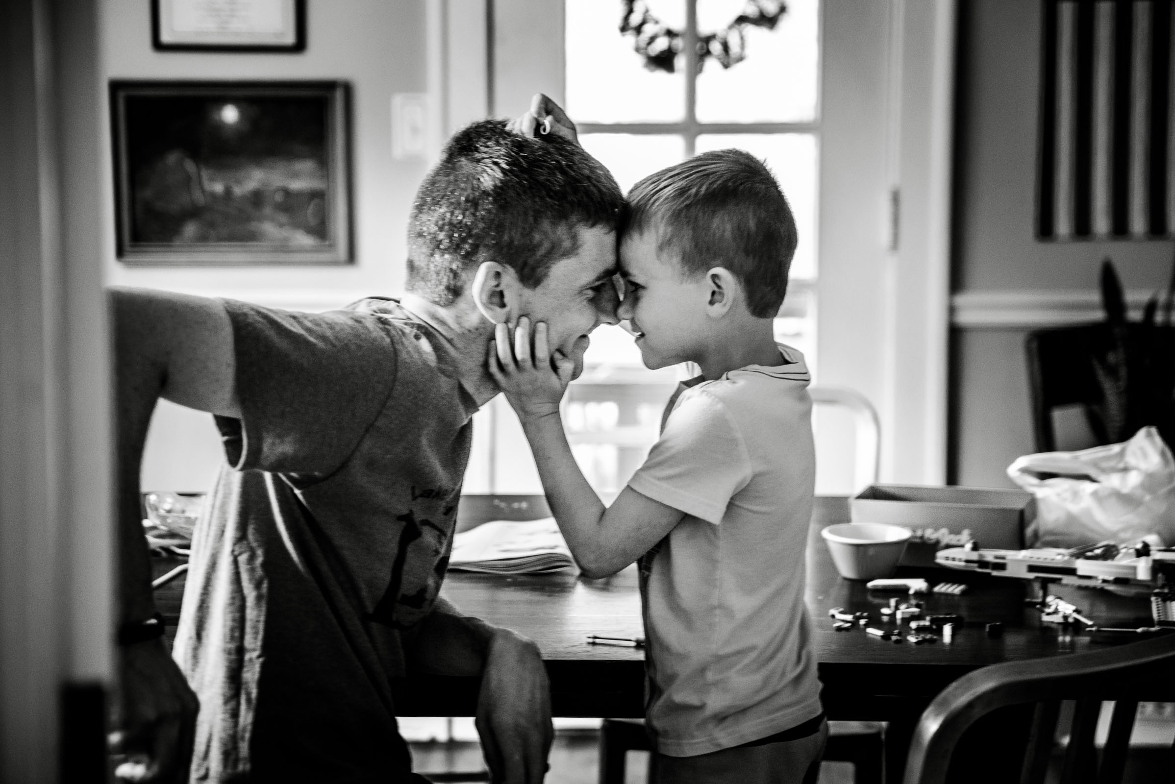 boy and father touching noses, out of focus, imperfect