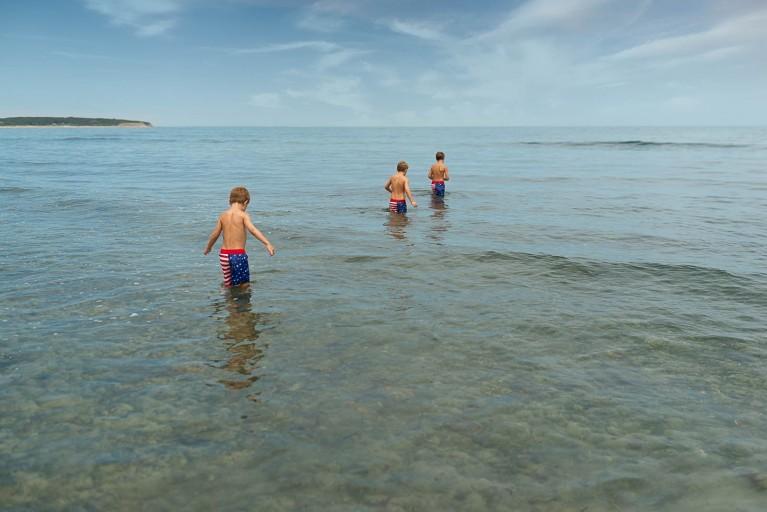 Boys in a lake taken with Tamron 35mm lens