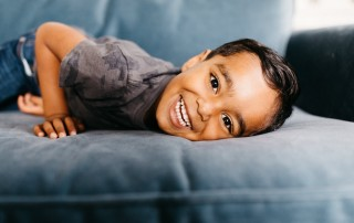 Little boy laying on sofa - Photographing shy kids
