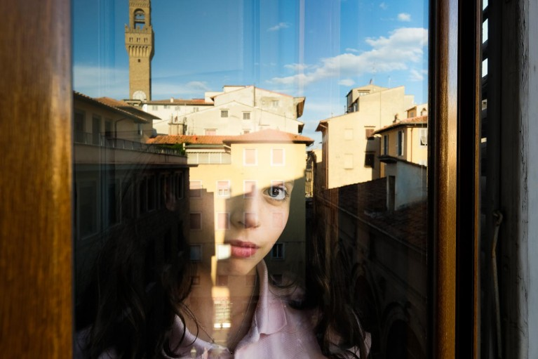 How to build a powerful photography portfolio: girl looking out window