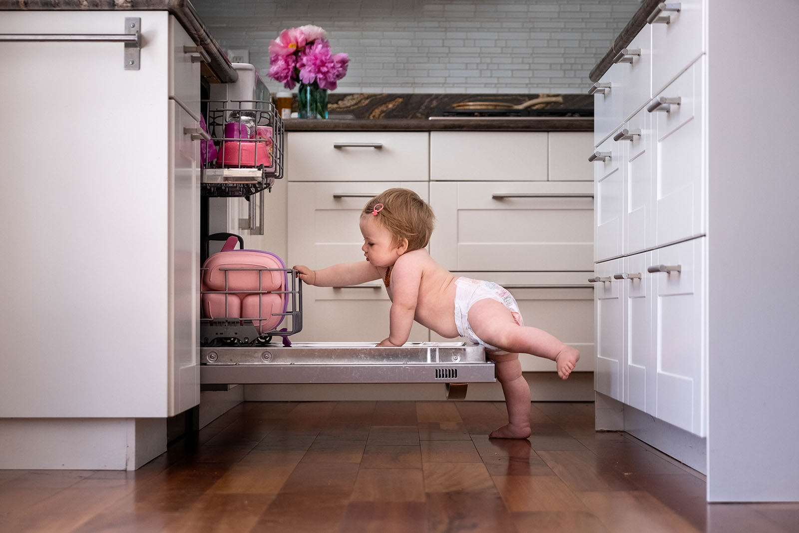 Baby reaching for dishwasher, taken with fujifilm mirrorless