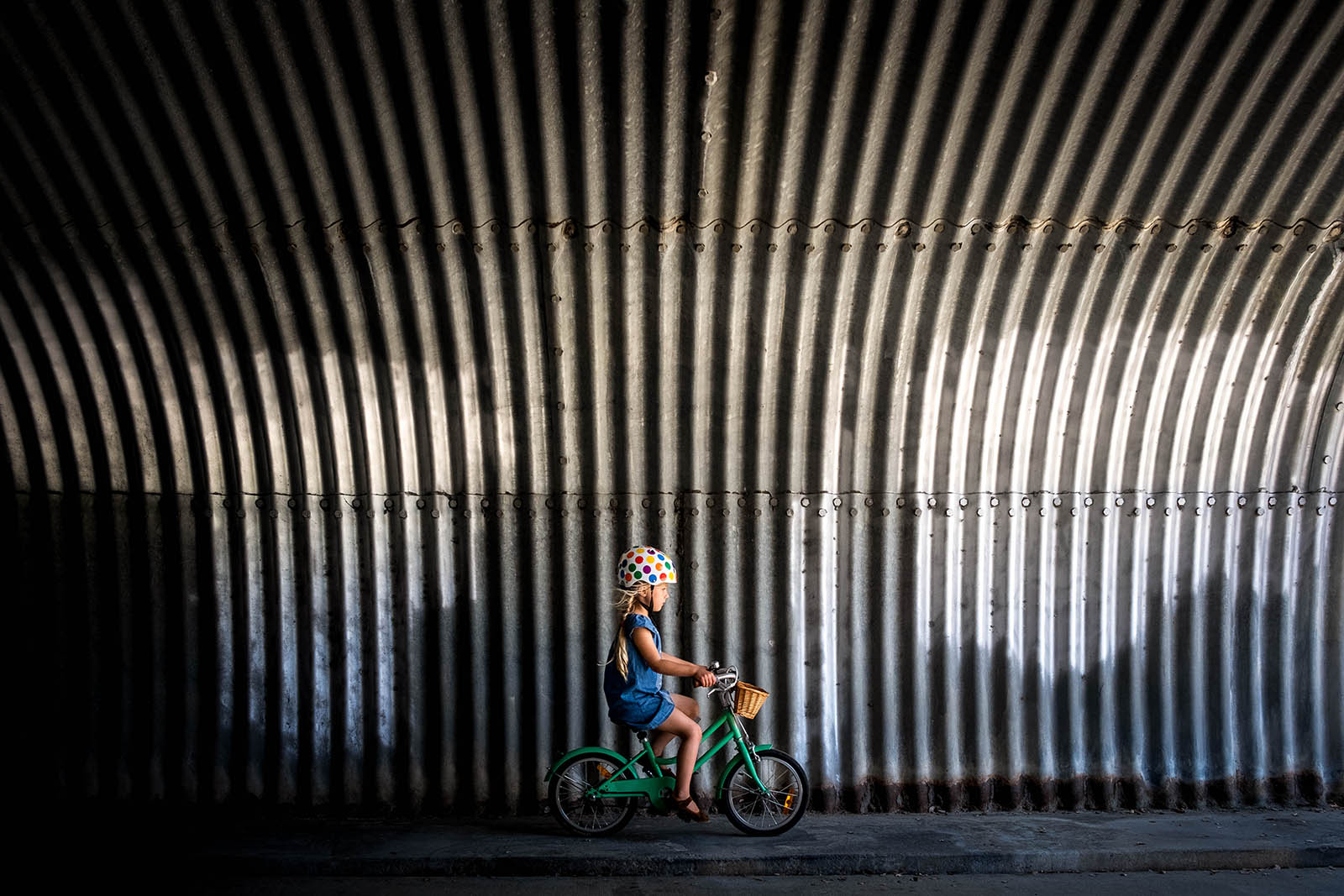 Girl on bike in tunnel, taken with Fujifilm mirrorless camera