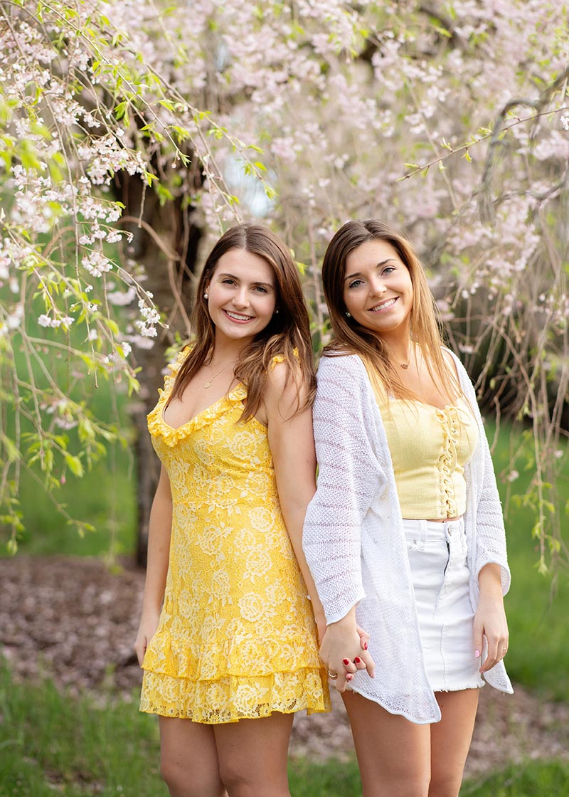 Twin senior girls at a photo session in a park