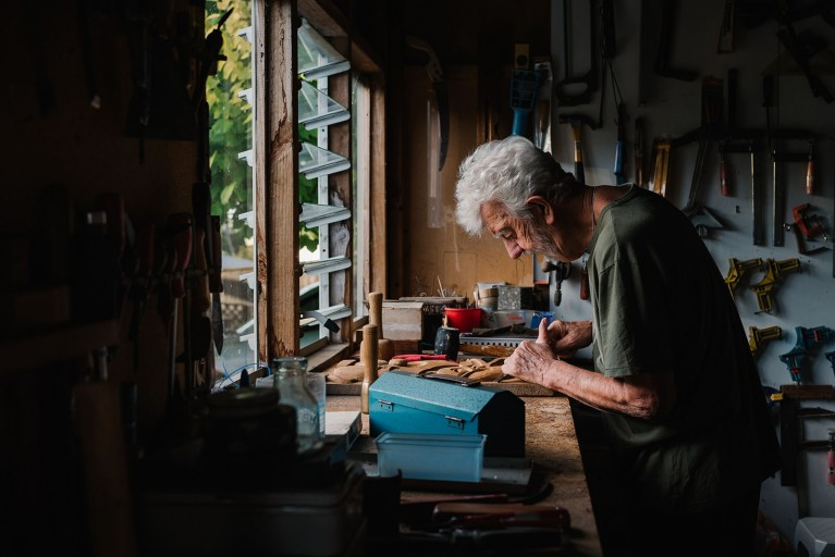 old man working in a workshop, a legacy contest winner