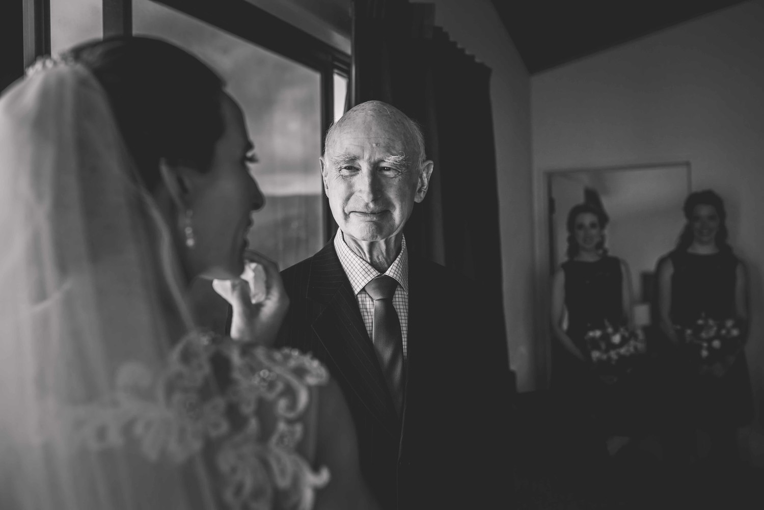 A dad sees the bride for the first time at her wedding