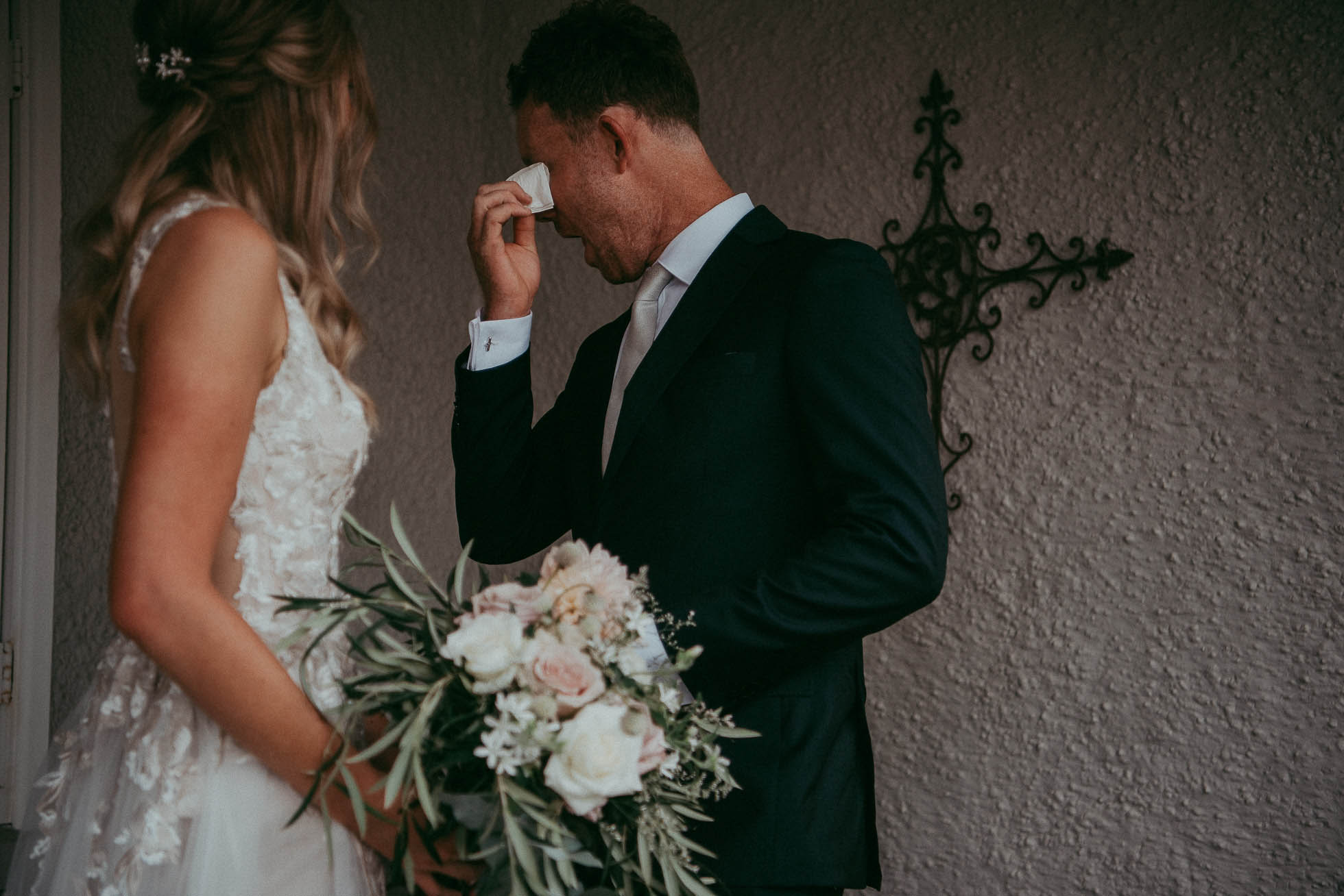 An emotional moment - A couple sees each other at their wedding