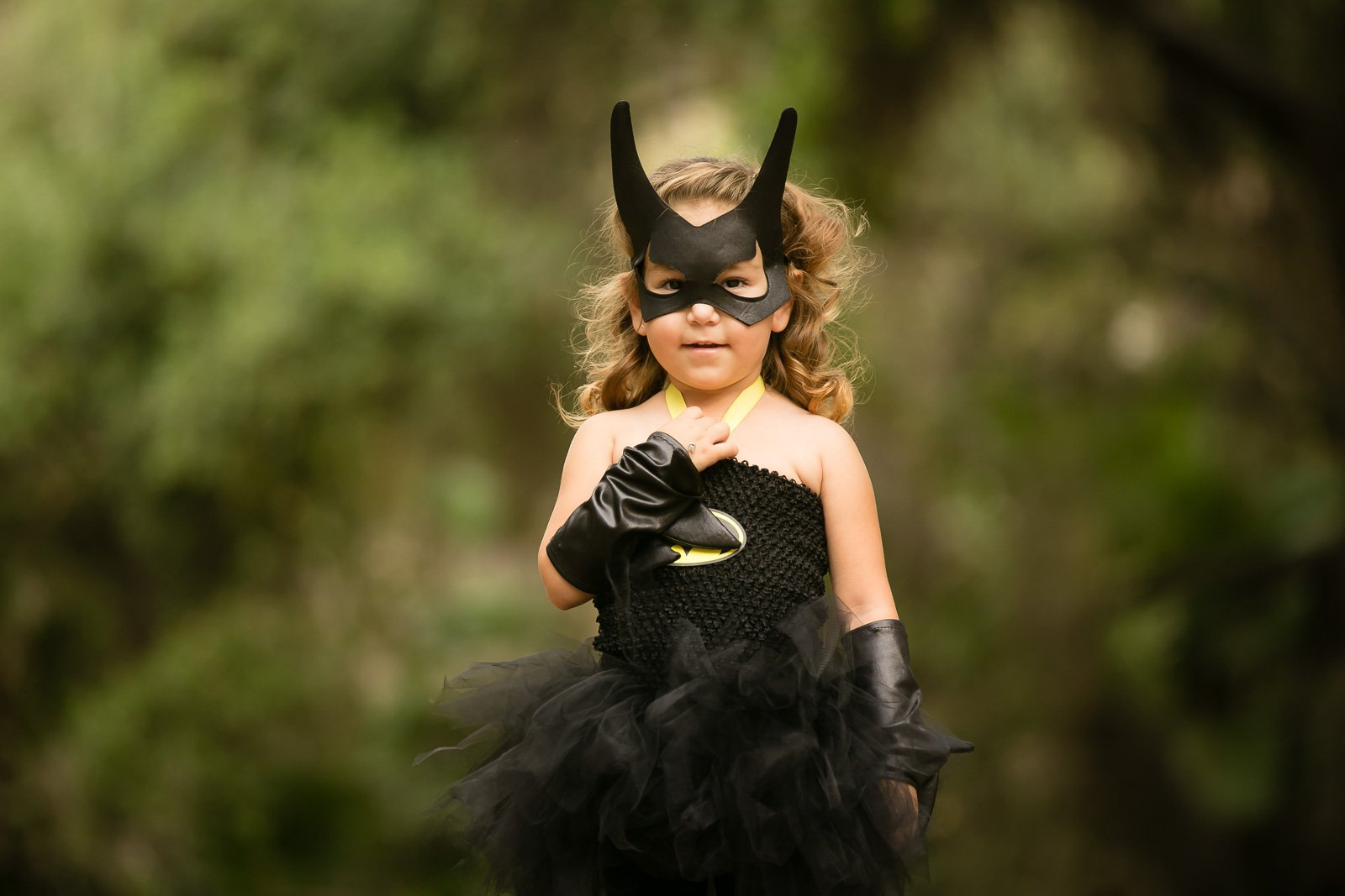 Halloween photo of girl in Batman costume