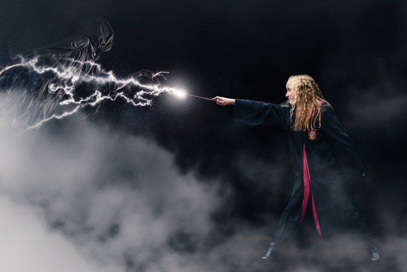 magical Halloween photo of girl with lightning rod