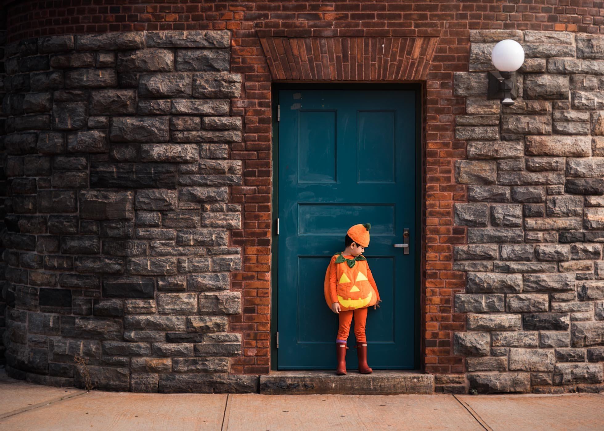 Halloween orange pumpkin against a blue door