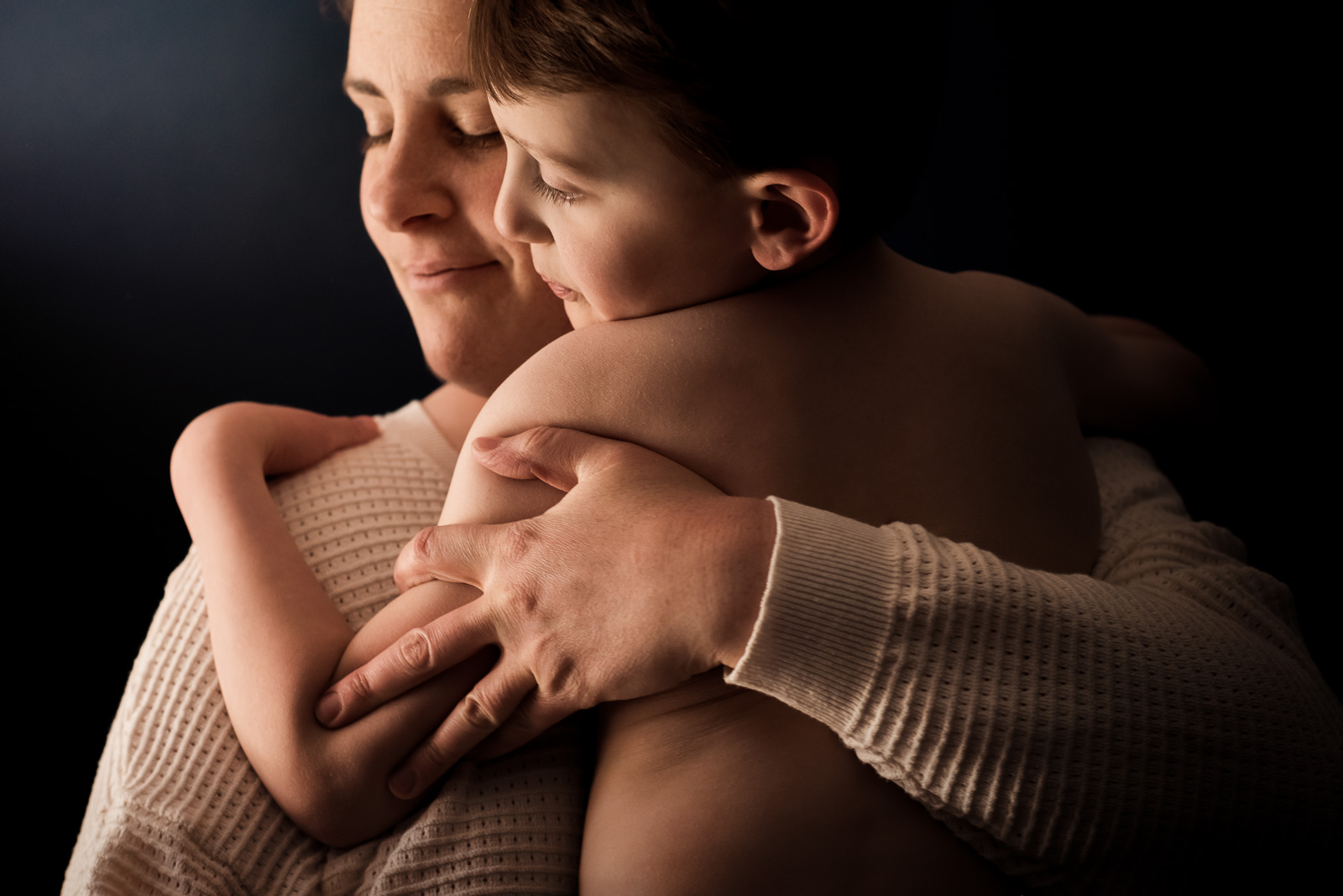 Photographing struggle - autistic child photographed with mom