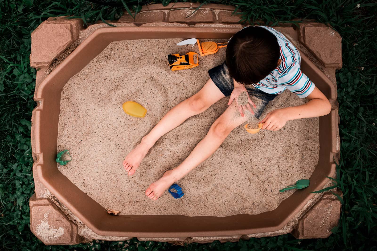 Photographing struggle - autistic child photo in sandbox