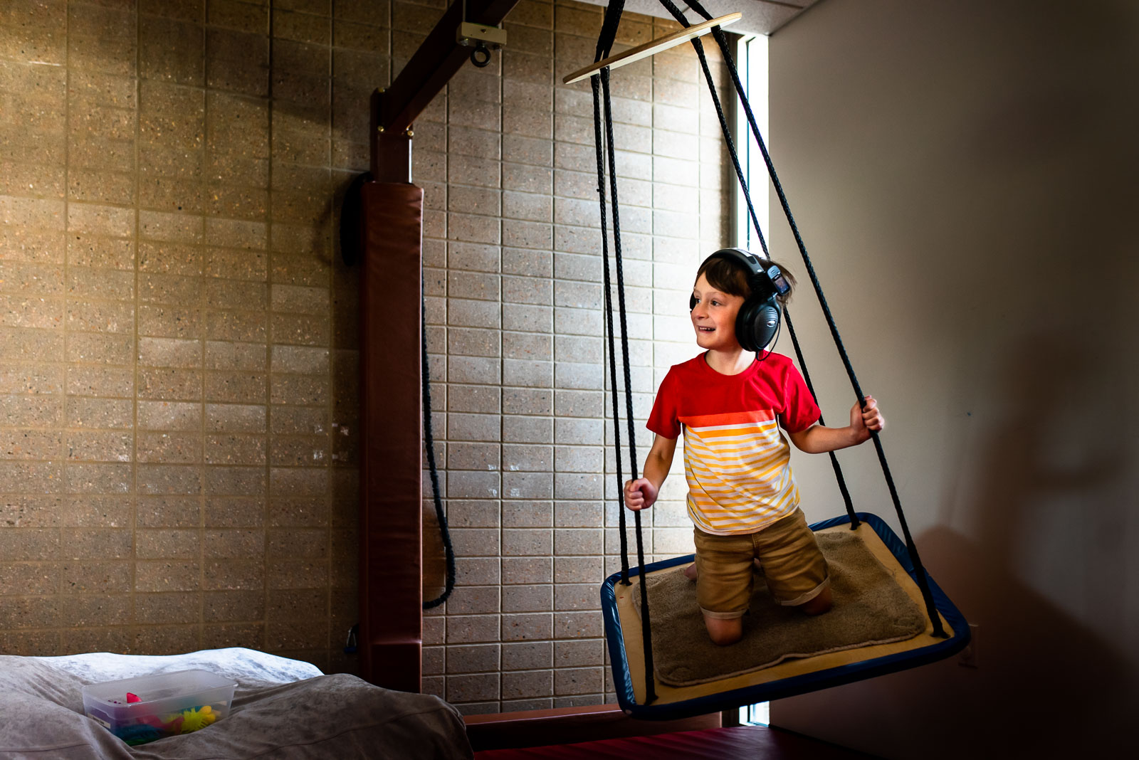 Photographing struggle - autistic child at therapy