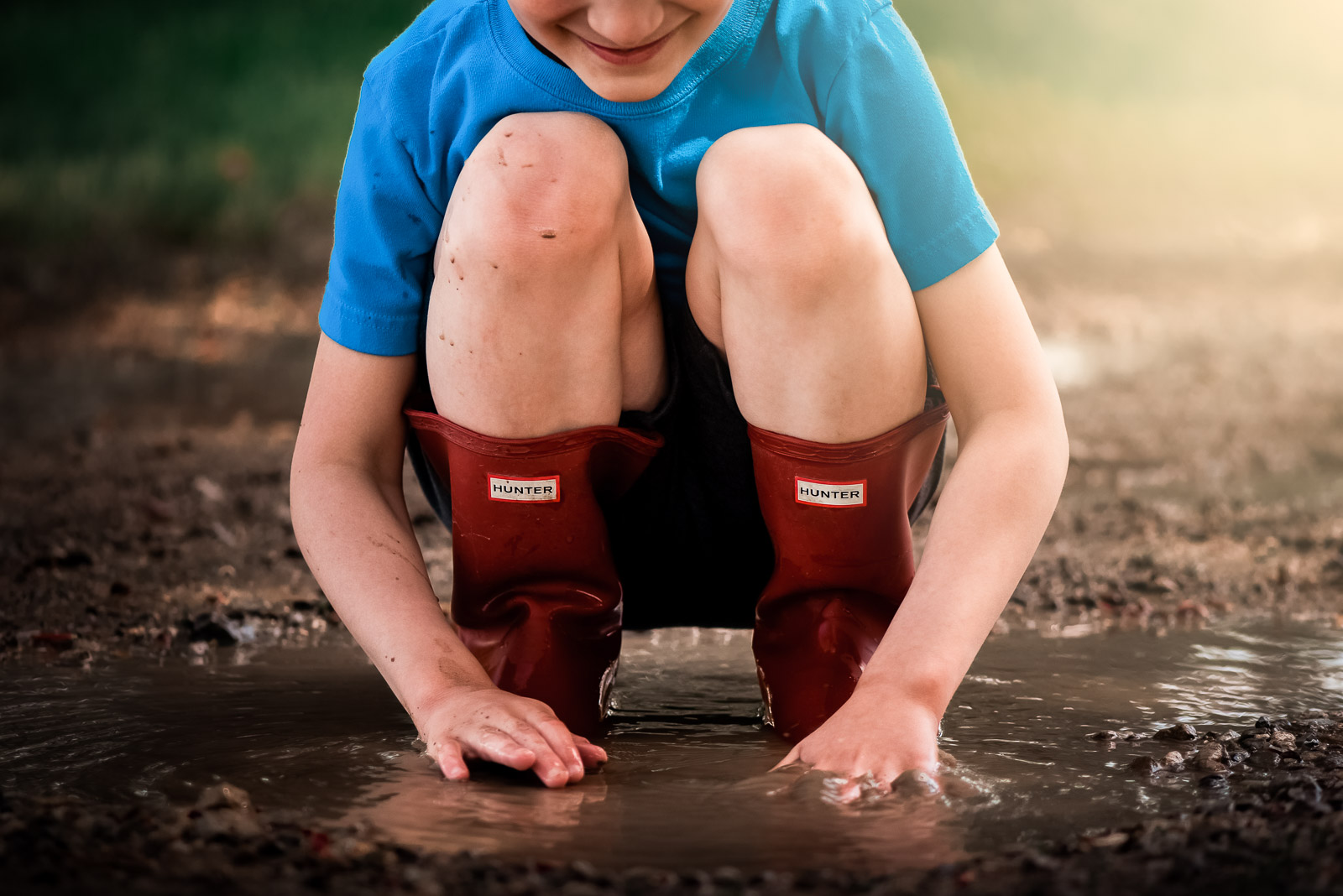 Photographing struggle - autistic child in mud puddle