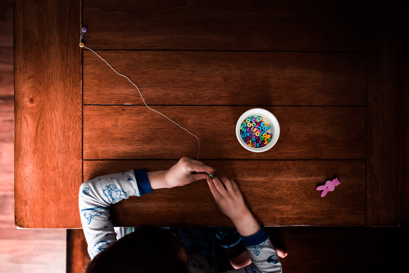 Photographing struggle - autistic child quietly at table