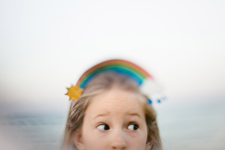 Freelensed image of girl with rainbow