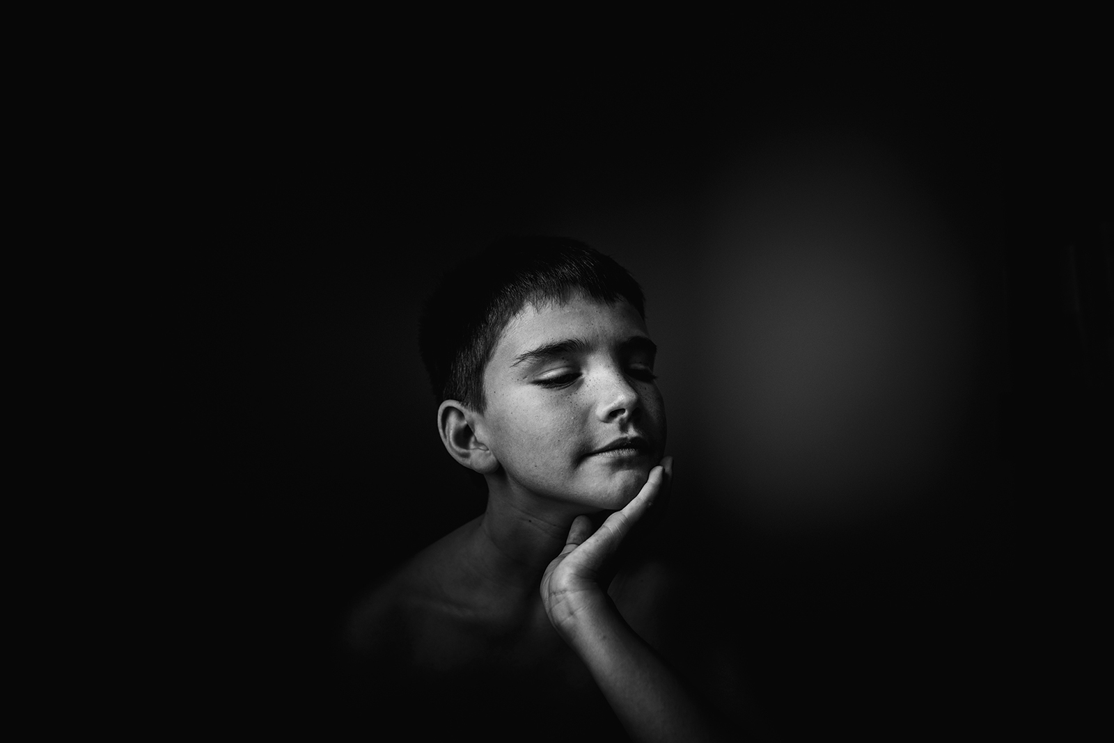 Soulful image of a boy in black and white