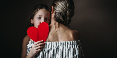 Soulful photography of mom holding daughter
